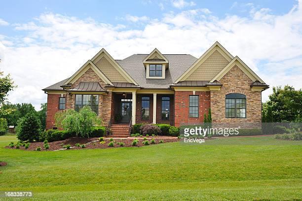 Luxurious country or suburban home exterior brick facade