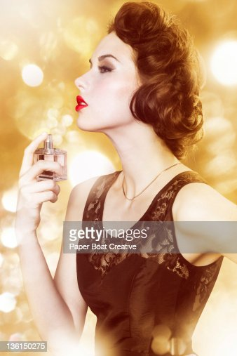 luxurious looking lady spraying on perfume