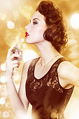 luxurious looking lady spraying on perfume
