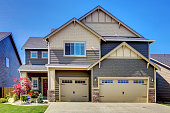 Luxurious modern house with two garage spaces, driveway and stone trim. Northwest, USA