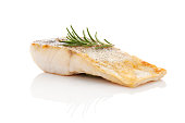 Luxurious seafood dinner. Perch fish fillet isolated on white background with fresh green herbs. Healthy eating.