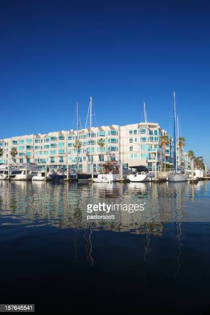 Luxury Apartment Building with Waterfront Boats at Marina