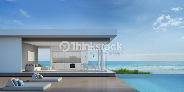 Luxury beach house with sea view pool in modern design : Stock Photo
