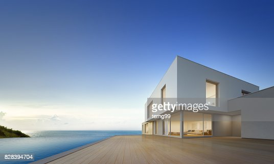 Luxury beach house with sea view swimming pool and empty terrace in modern design, Vacation home for big family on blue sky background : Stock Photo