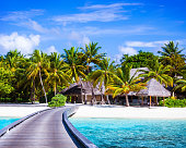 Luxury beach resort, footbridge to the paradise, little wooden houses, summer holidays, Maldives island, travel and tourism concept