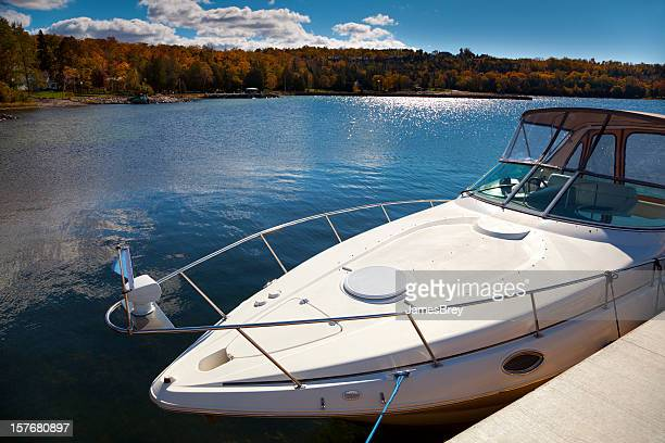 Luxury Boat Moored in Sunny Autumn Harbor