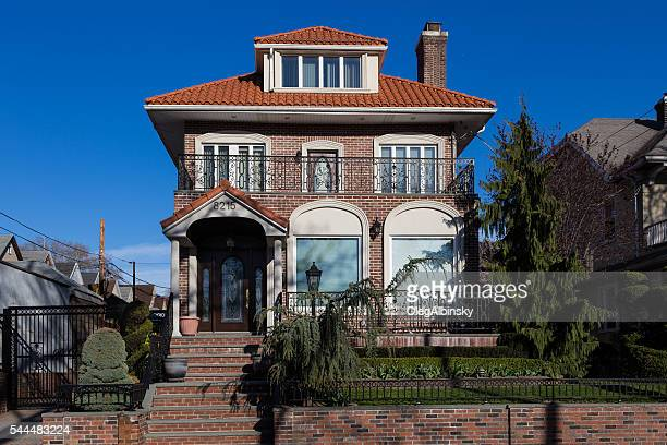 Luxury Brooklyn House with Red Tile Roof, Blue Sky, NYC.