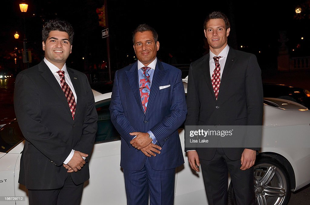 Luxury car Audi sponser representatives pose with John Kushnir CFO of Niche Media (C) during Philadelphia Style Magazine Cover Event Hosted By Chris Matthews on November 19, 2012 in Philadelphia, Pennsylvania.