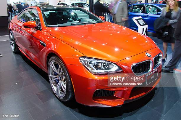 CENTRE TORONTO ONTARIO CANADA Luxury car BMW on stand with the people in the background in Canada International Auto Show Bayerische Motoren Werke AG...