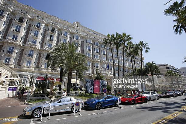 Luxury cars are parked outside the Carlton Hotel in Cannes southeastern France on July 26 2015 AFP PHOTO / VALERY HACHE