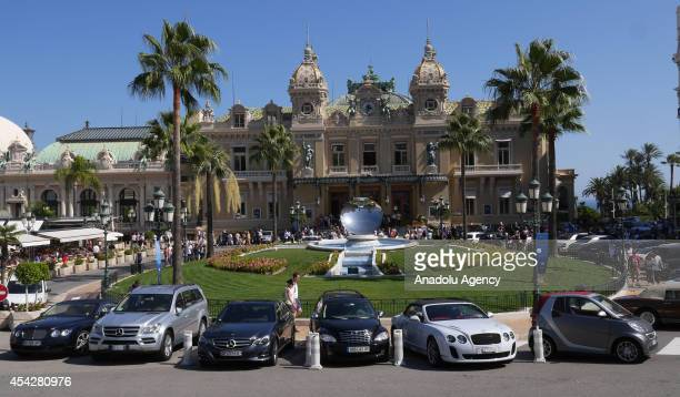 Luxury cars are seen on the steet of Monaco prior to the UEFA Champions League draw in Monaco on August 27 2014 The 32 clubs 22 of which qualified...