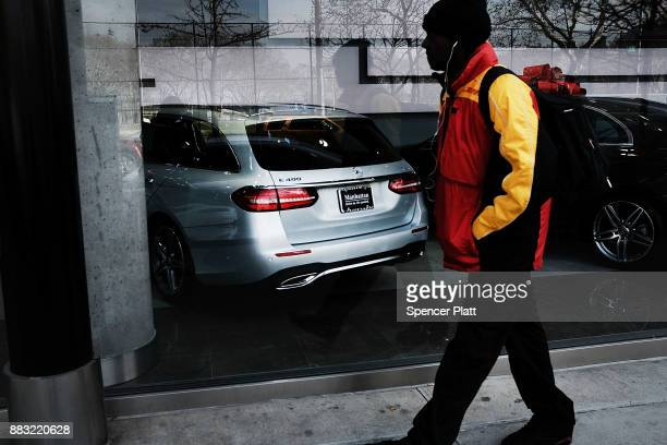 Luxury cars sit on display in a dealership in Manhattan on November 30 2017 in New York City Republicans are coming closer to getting the votes...