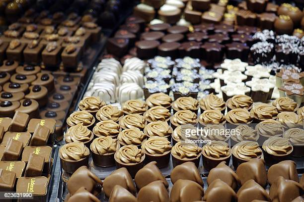 Luxury chocolates sit on display in the window of a chocolatier in Locarno Switzerland on Tuesday Nov 15 2016 While the Swiss National Bank admitted...