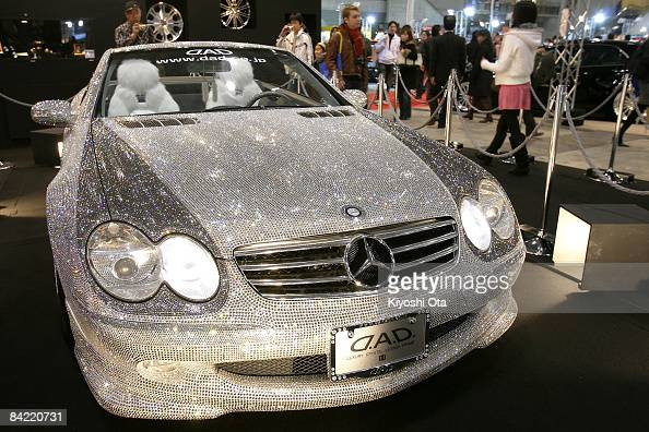 A 'Luxury Crystal Benz' the customized MercedesBenz SL600 with 300000 Swarovski crystals is displayed at a booth at Tokyo Auto Salon 2009 at Makuhari...