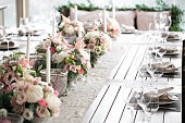 Luxury, elegant wedding reception table arrangement, floral centerpiece. Professional work florists. Decoration family dinner