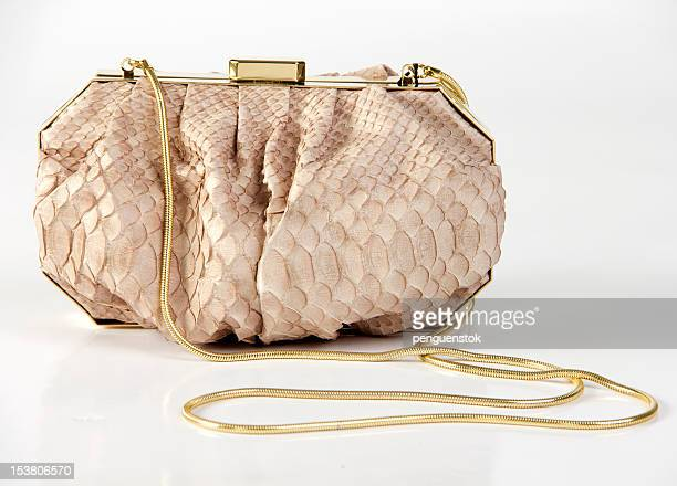 Luxury handbag with gold chain isolated on white background