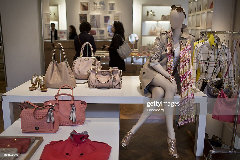 coach usa outlet online store af17  Luxury handbags and shoes are displayed for sale at a Coach Inc store in  New