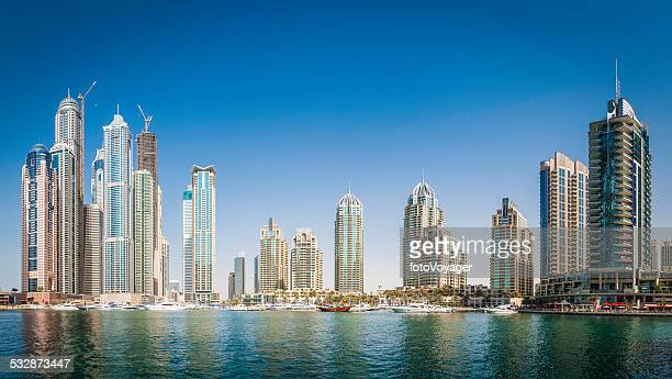 Luxury highrise apartments soaring into blue sky above Dubai Marina