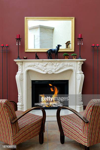 Luxury home interior with classic romantic marble fireplace
