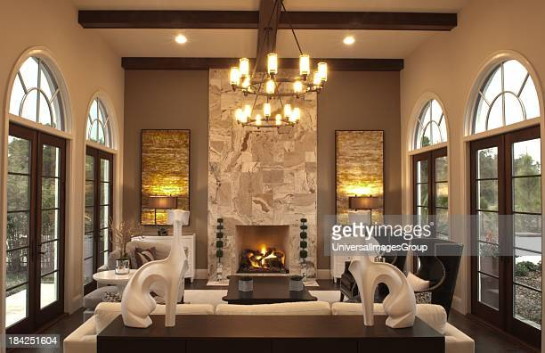 Luxury Home worth several million dollars den with fireplace called Florida room
