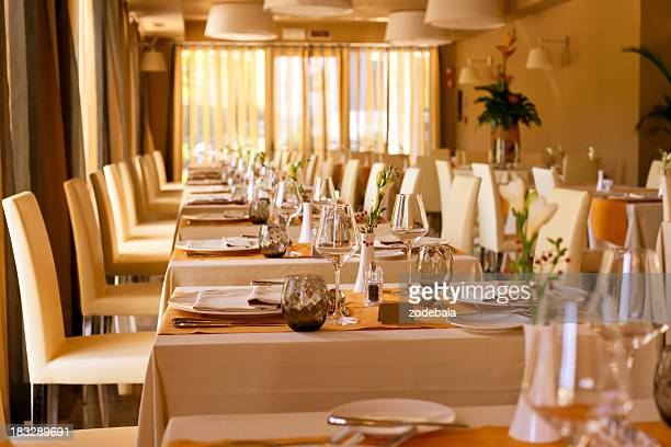 Luxury hotel restaurant table and chairs setting