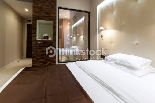 Luxury Hotel Suite With Shower Visible From Bedroom Stock