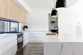 Luxury industrial scandi kitchen with a marble island bench