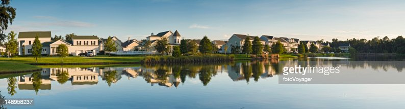 Luxury lake shore homes reflected