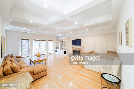 Luxury Living Room And Kitchen With Tray Ceiling Stock Photo