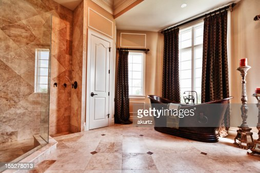Luxury Master bathroom with a copper tub and Roman shower