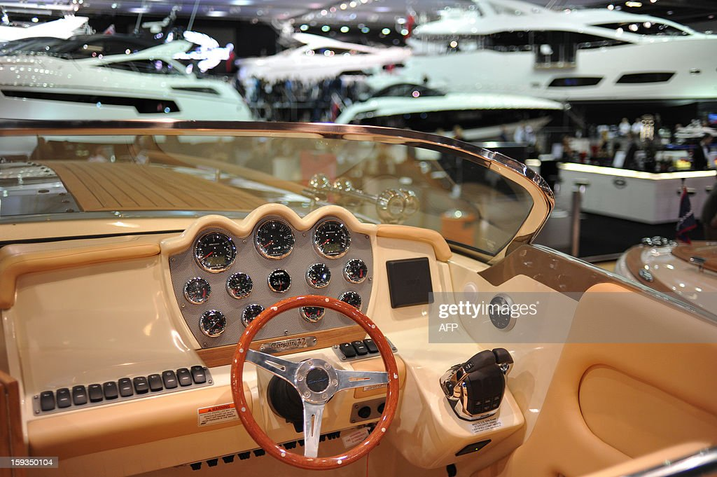 Luxury motor boats are pictured on display at the London Boat Show in east London on January 12, 2013. AFP PHOTO / CARL COURT
