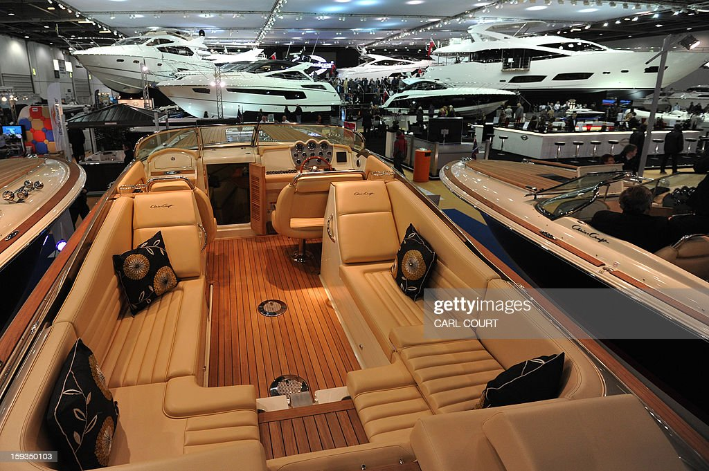 Luxury motor boats on display at the 2013 London Boat Show in east London on January 12, 2013. The nine-day show features everything from speedboats to dinghies, boat paint to hot tubs with exhibits from many major marine and watersports related brands.
