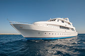 Large luxury motor yacht on a tropical sea