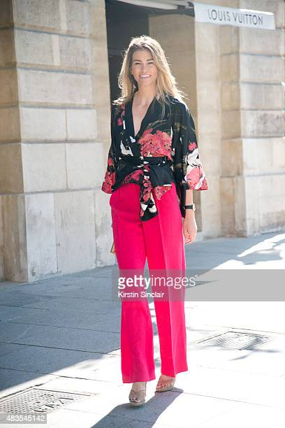 Luxury PR consultant Lorena Verjani wears a Japanese Kimono and Jimmy Choo shoes on day 2 of Paris Fashion Week Haute Couture Autumn/Winter 2015 on...