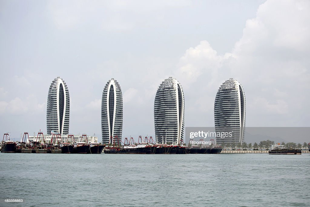 Luxury residential buildings stand on Phoenix Island in the Sanya Bay district of Sanya, Hainan Province, China, on Monday, April 7, 2014. The yuan is poised to recover from declines that have made it Asia's worst-performing currency as China seeks to prevent an exodus of capital that would threaten economic growth, according to the most accurate forecasters. Photographer: Brent Lewin/Bloomberg via Getty Images