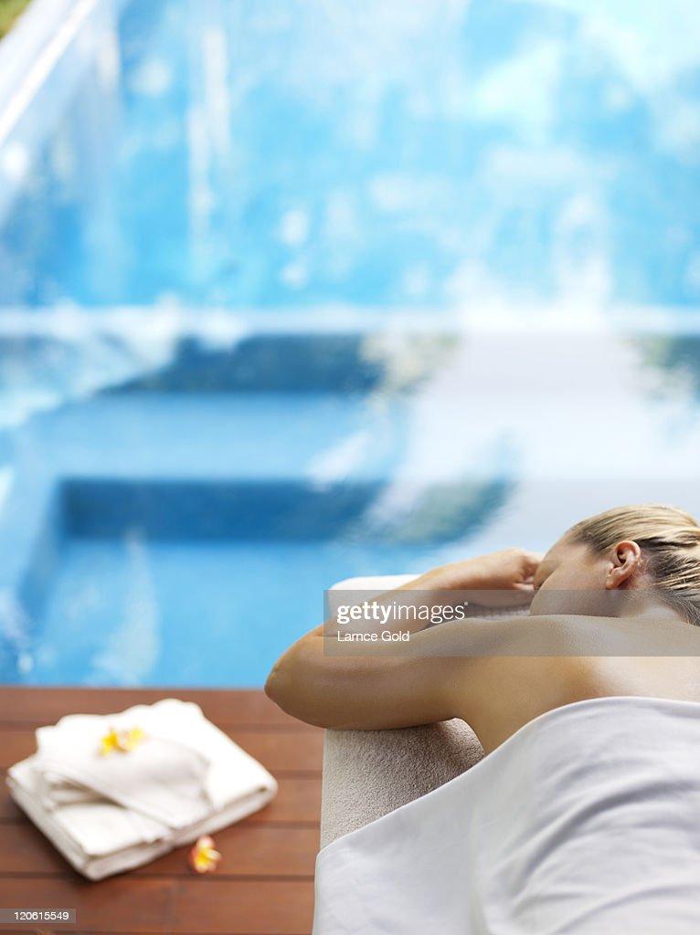 Luxury resort massage by the pool : Stock Photo