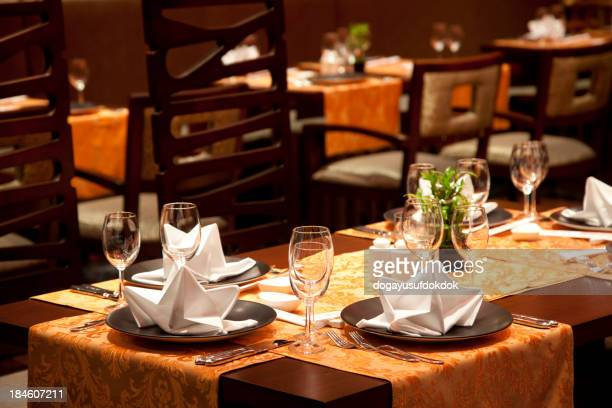 Luxury restaurant with wine glasses and table set up