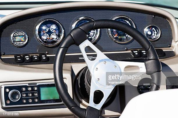 Luxury speedboat control panel with steering wheel, front view