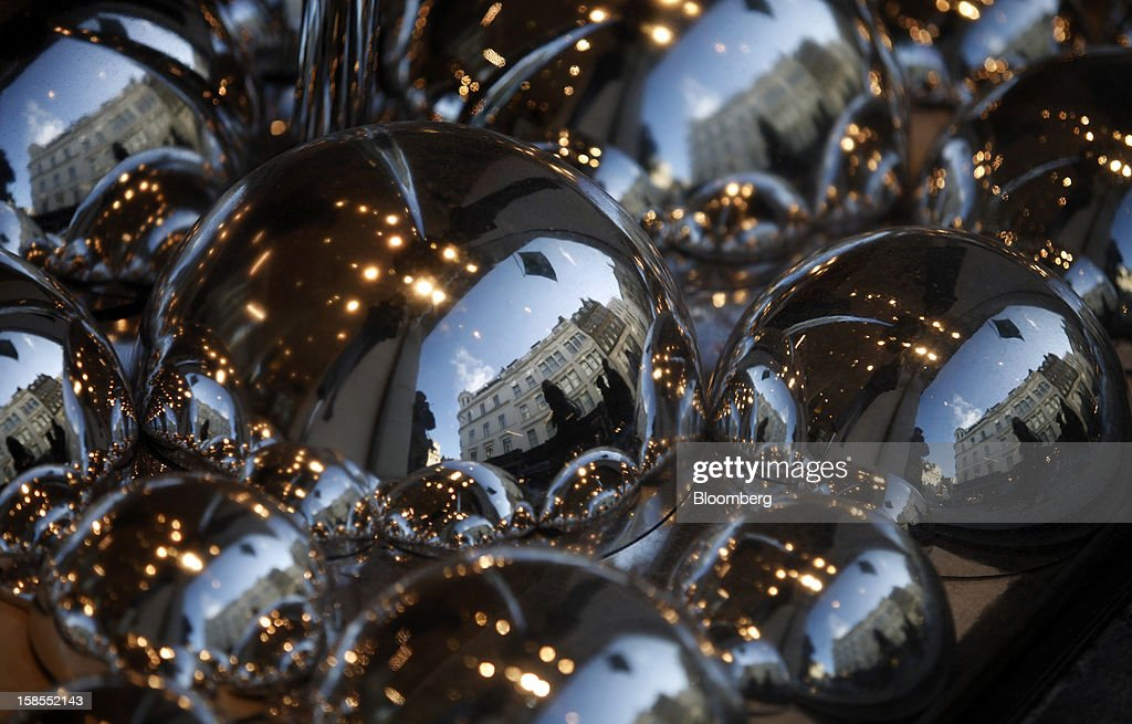 Luxury stores are reflected in the Christmas window display of the Fenwick department store on New Bond Street in London, U.K., on Monday, Dec. 17, 2012. Retailers are relying on Christmas sales to help rescue a year when high unemployment and the debt crisis have blighted spending. Photographer: Simon Dawson/Bloomberg via Getty Images