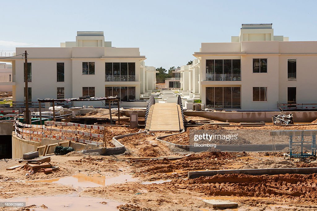 Luxury villas stand near unfinished construction works at 'The Keys' development at Quinta do Lago in Almancil, Algarve region, Portugal, on Saturday, March 9, 2013. The tourism and real estate sector's recovery is crucial for Portugal's economy, which the government projects will return to growth next year, after shrinking an estimated 1 percent in 2013 and 3 percent in 2012. Photographer: Mario Proenca/Bloomberg via Getty Images
