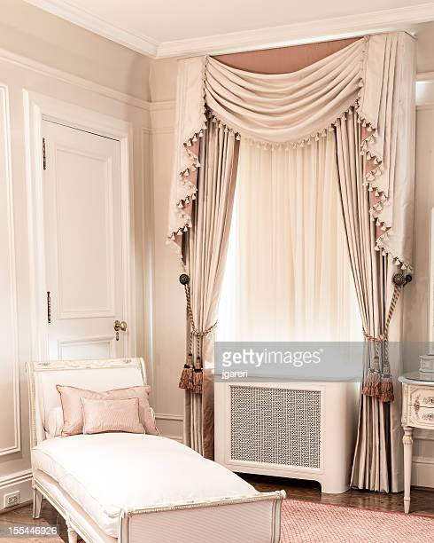 Luxury white and beige bedroom with single bed and curtains