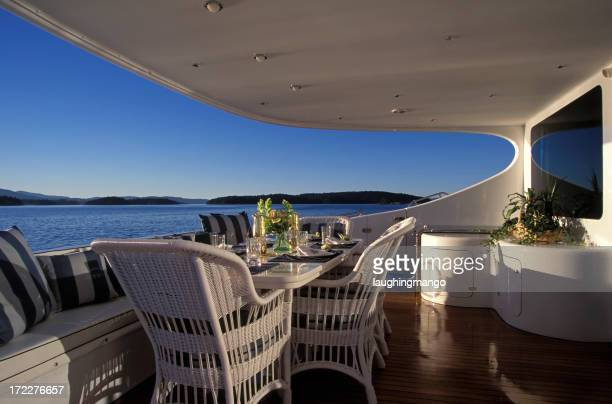 A luxury yacht deck with furniture