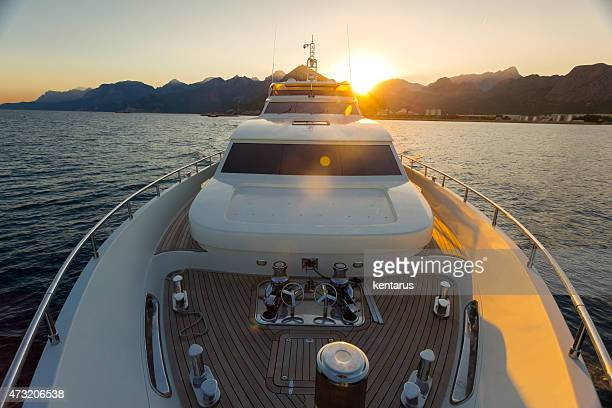 Luxury yacht sailing on the sea during sunset
