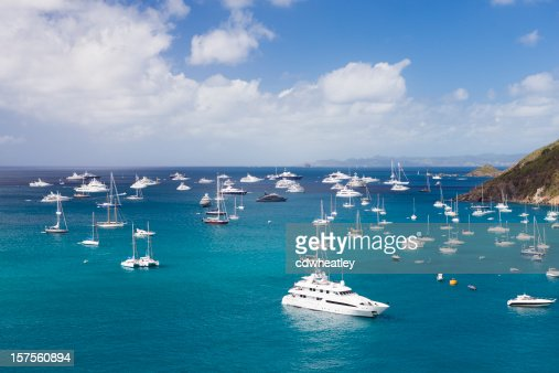 luxury yachts at anchor in the Caribbean harbor
