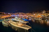 Luxury yachts docked in the harbor at night