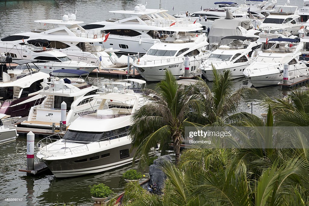 Luxury yachts sit docked at the Visun Royal Yacht Club in the Sanya Bay district of Sanya, Hainan Province, China, on Monday, April 7, 2014. The yuan is poised to recover from declines that have made it Asia's worst-performing currency as China seeks to prevent an exodus of capital that would threaten economic growth, according to the most accurate forecasters. Photographer: Brent Lewin/Bloomberg via Getty Images