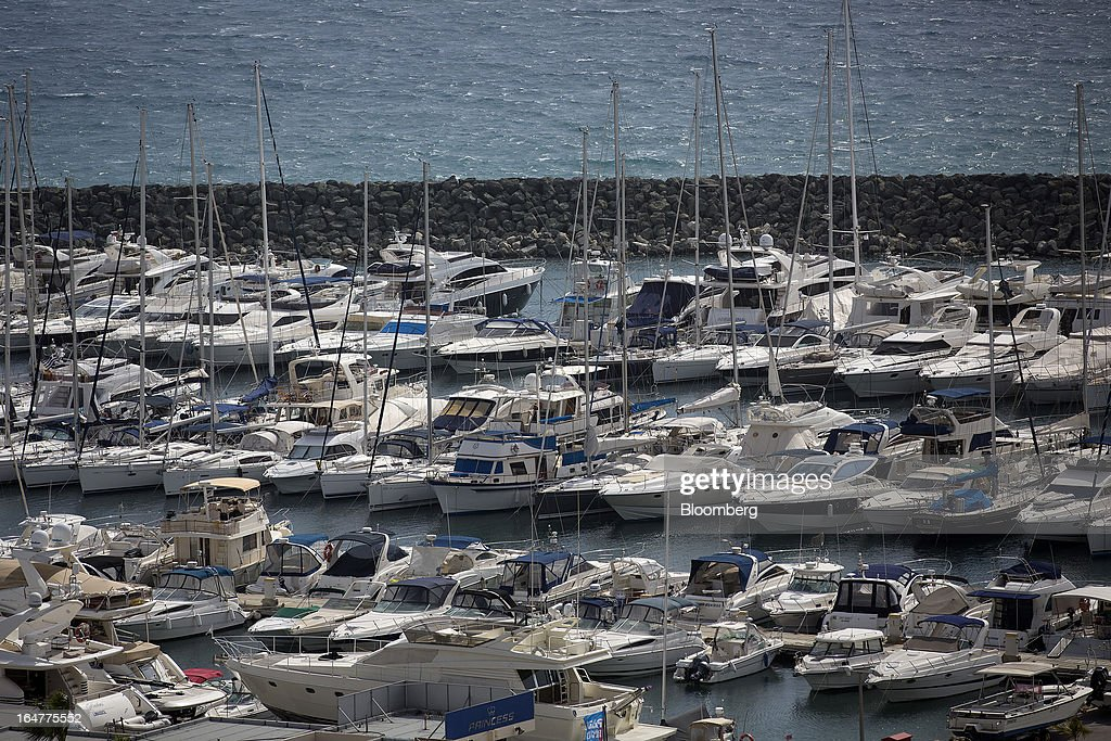Luxury yachts sit moored at St Raphael Dock in Limassol, Cyprus, on Wednesday, March 27, 2013. Directly or indirectly, tourism makes up a quarter of Cyprus's economy with visitors from the two main tourism markets, Germany and U.K. Photographer: Simon Dawson/Bloomberg