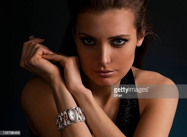 luxury young dark-haired girl in exclusive jewelry wrist watch