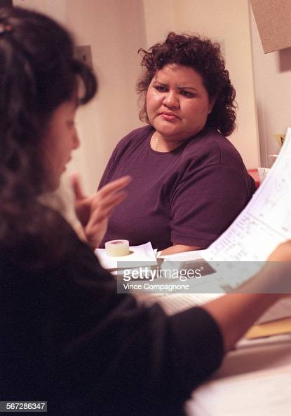 Luz Manzo##right%% a patient at USC Medical Center talks with nurse Margo Contreras after Manzo's breast examination
