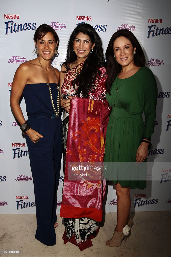 Luz Maria Zetina, Bhangra Masala and Gloria Calzada (L-R) pose for a photo during the presentation of Bhangra Masala Workout for Nestle Fitness at Joy Room on June 2, 2010 in Mexico City, Mexico.